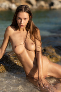 Beautiful Busty Chick Alina Strips Her Bikini