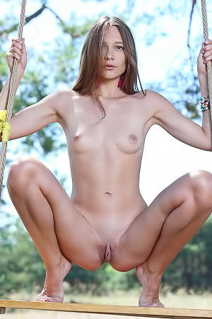 Hottie swings totally naked in the local park