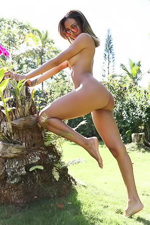 Exotic Teen Abril Posing In Tropical Garden