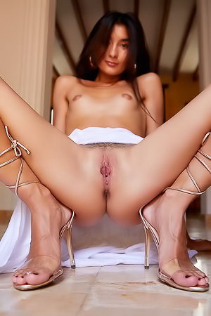 Trimmed Asian pussy in high heels