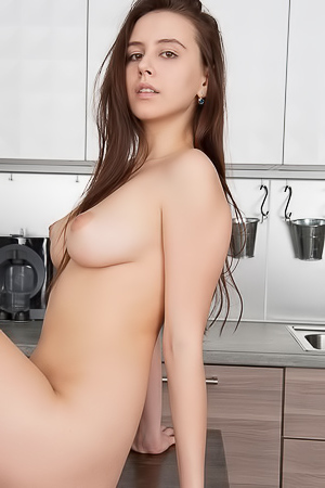 Babe starts her morning on the kitchen floor