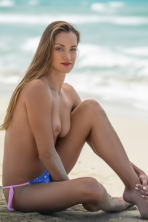 Nicole Fox gets naked and dirty at the beach