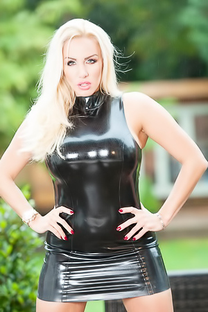 Tempting blonde Dannii Harwood wearing a black latex dress