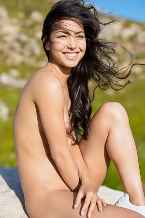 Chloe Rose does some naked climbing while on vacation