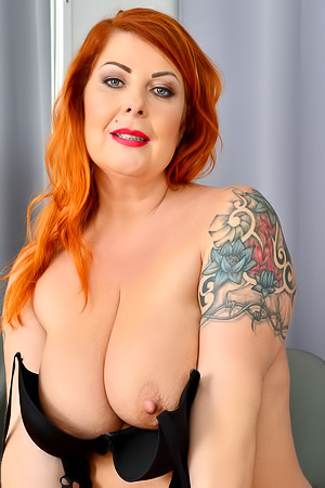 Tammy Jean Tammy Jean squeezes her chubby boobs and pussy