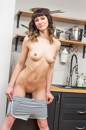 Triste - Naked brunette hottie orgasms on a kitchen table